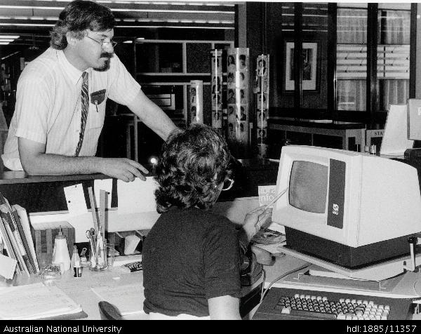 Tony Barry, ANU Deputy University Librarian, inspecting computerised library system in 1986
